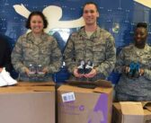 Eglin members donate shoes to CIC Kids