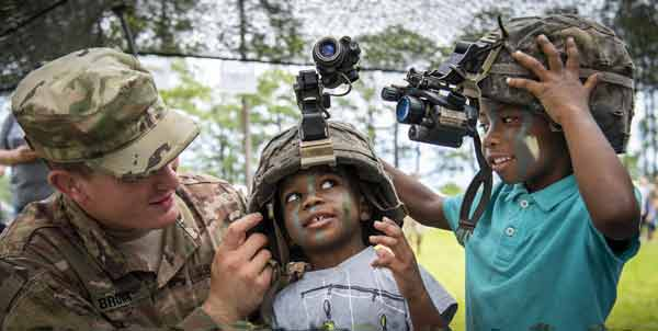 A Soldier helps two young recruits try on helmets during the 6th Ranger Training Battalion's open house event May 11 at Eglin Air Force Base, Fla