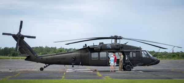 A couple receive a tour of a Blackhawk helicopter during the 6th Ranger Training Battalion's open house event