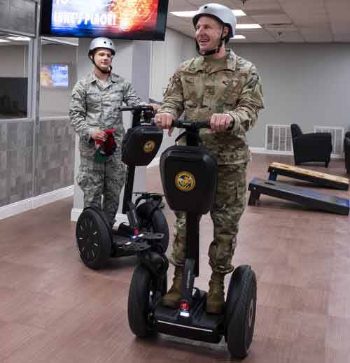 Maj. Gen. Carl Schaefer tests a segway at eglin air force base