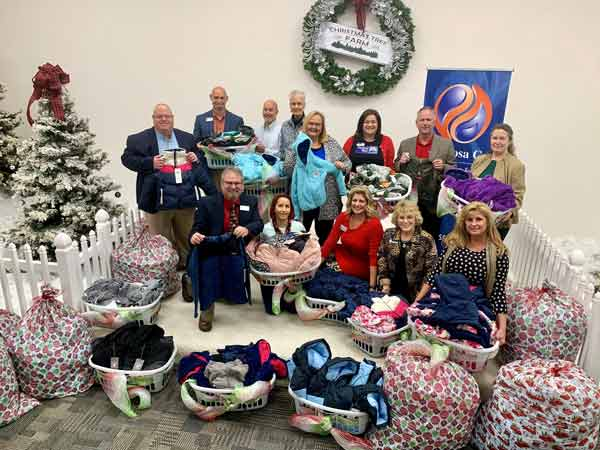 Okaloosa Gas employees with coats