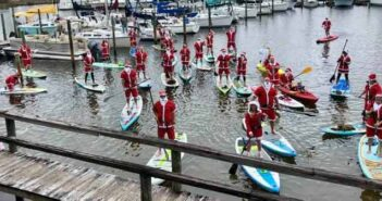 santas on paddleboards at Bluewater Marina in Niceville 2019